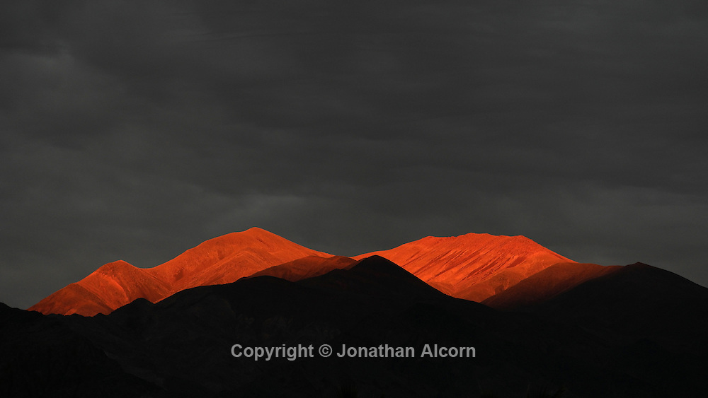 The last sun rays of the day strike the mountains on January 10, 2015 in Death Valley, California