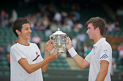 LONDON, ENGLAND - Sunday, July 3, 2011: Mate Pavic (CRO) (L) and George Morgan (GBR) (R) celebrate with the trophy after winning the Boys' Doubles Final match on day thirteen of the Wimbledon Lawn Tennis Championships at the All England Lawn Tennis and Croquet Club. (Pic by David Rawcliffe/Propaganda)