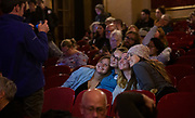 A group of young supporters sits for a picture during the Tony Evers Election Night watch party at the Orpheum Theater in Madison, Wisconsin, Tuesday, Nov. 6, 2018.