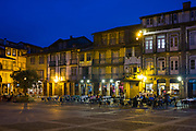 Night life at pavement cafes in central square in quaint town of Guimaraes in Northern Portugal