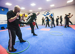 Students using the hoops, Stef Noij, KMG Instructor from the Institute Krav Maga Netherlands, takes the IKMS G Level Programme seminar today at the Scottish Martial Arts Centre, Alloa.