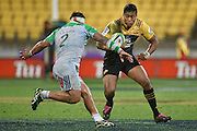 Hurricanes' Julian Savea (R is tackled by Highlanders' Ash Dixon during the Hurricanes vs Highlanders Super Rugby  match at the Westpac Stadium in Wellington on Friday the 27th of May 2016. Copyright Photo by Marty Melville / www.Photosport.nz