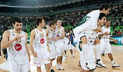 Klemen Lorbek (25) of Olimpija, Goran Jagodnik (12) of Olimpija, Damir Markota (22) of Olimpija,  Zoran Vrkic of Olimpija and Giorgi Shermadini (16) of Olimpija celebrate after winning the basketball match between KK Union Olimpija (SLO) and Armani Jeans Milano (ITA) in Group D of Turkish Airlines Euroleague, on December 2, 2010 in SRC Stozice, Ljubljana, Slovenia. Union Olimpija defeated AJ Milano 82-75 and qualified to 16 best teams of Euroleague.  (Photo By Vid Ponikvar / Sportida.com)