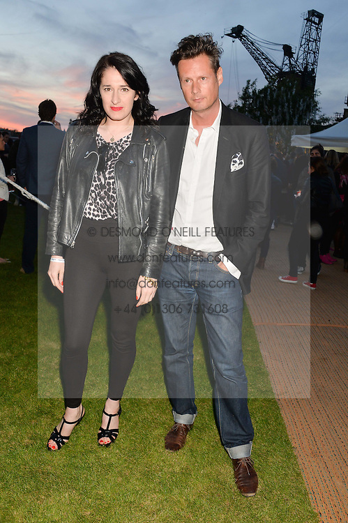 AMY MOLYNEAUX and PERCY PARKER at the Battersea Power Station Annual Party at Battersea Power Station, 188 Kirtling Street, London SW8 on 30th April 2014.