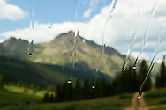 Alpine landscape in Lincoln Creek Drainage near Aspen, CO as seen from a car's windshield
