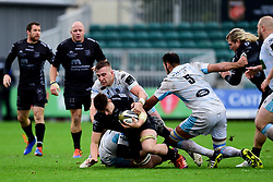 Taine Basham of Dragons is tackled by Matt Fagerson of Glasgow Warriors - Ryan Hiscott/JMP - 25/10/19 - SPORT - Rodney Parade - Newport, Wales -
