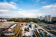 Elevated view across museum site with cityscape beyond. Silesian Museum, Katowice, Poland. Architect: Riegler Riewe Architekten , 2014.