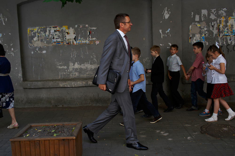 Ivan Mikloš passes a group of school children as he walks to a meeting near his office on May 25, 2015 in Kyiv, Ukraine. Mr. Mikloš is Chief Advisor to the Minister of Finance of Ukraine and Advisor to the Minister of Economic Development and Trade of Ukraine.