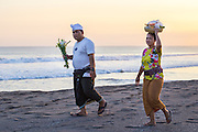 Bringing offerings to a temple at Kayu Putih beach in Canggu.