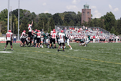 09 September 2006 Titan kicker Mike Berry sends the ball towards the uprights as defender Nate Hughes goes high to attempt a behind the line block...In the first ever football competition between the Olivet Comets and the Illinois Wesleyan Titans, the Titans strut off the field with a 21- 6 victory. .Game action took place at Wilder Field on the campus of Illinois Wesleyan University in Bloomington Illinois.