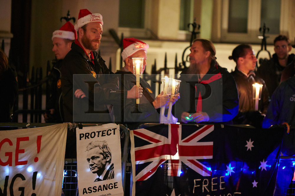 © Licensed to London News Pictures.  20/12/2012. LONDON, UK. .Supporters of Julian Assange (not pictured) gather outside of the Ecuadorean embassy in Knightsbridge ahead of a planned address from a balcony of the wikileaks founder. He has been in the embassy for 6 months avoiding extradition to Sweden.  . Photo credit :  Cliff Hide/LNP