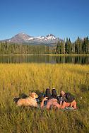 USA, Oregon, Lane  County, Willamette National Forest,Scott LakeUSA, Oregon, Lane  County, Willamette National Forest,Scott Lake,couple with dog tanning at lake<br /> <br /> MR  0514, 0515USA, Oregon, Lane  County, Willamette National Forest,Scott Lake,couple with dog tanning at lake<br /> <br /> MR  0514, 0515