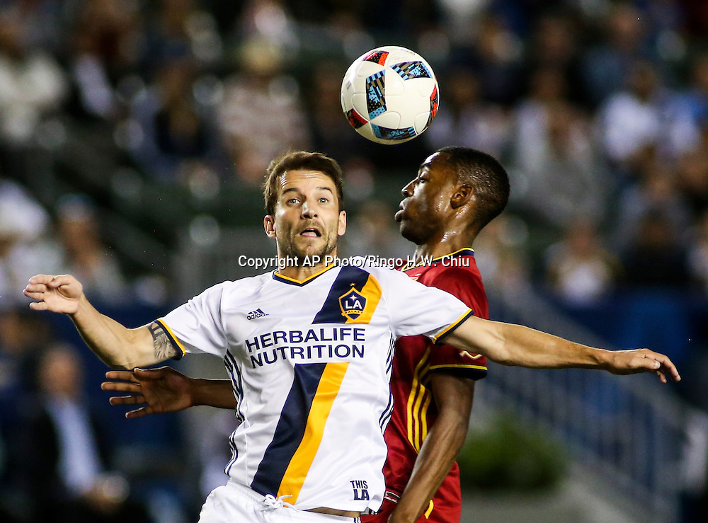 Los Angeles Galaxy midfielder Mike Magee, left, and Real Salt Lake defender Aaron Maund battle for a ball in the first half of an MLS soccer game in Carson, Calif., Saturday, April 23, 2016. (AP Photo/Ringo H.W. Chiu)