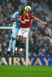 MANCHESTER, ENGLAND - Sunday, January 8, 2012: Manchester City's Micah Richards in action against Manchester United's Nani during the FA Cup 3rd Round match at the City of Manchester Stadium. (Pic by David Rawcliffe/Propaganda)