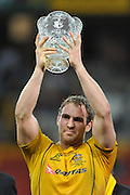 Rocky Elsom raises the Landsdowne Cup above his head during action from the Rugby Union Test Match played between Australia and Ireland at Suncorp Stadium (Brisbane) on Saturday 26th June 2010 ~ Australia (22) defeated Ireland (15) ~ © Image Aura Images.com.au ~ Conditions of Use: This image is intended for Editorial use as news and commentry in print, electronic and online media ~ Required Image Credit : Steven Hight (AURA Images)For any alternative use please contact AURA Images