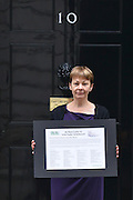 © Licensed to London News Pictures. 11/06/2013. Westminster, UK. Caroline Lucas MP holds the letter.  An open letter to Lord Taylor of Holbeach is handed into Downing Street today 11th June 2013 The letter from the British Union for the Abolition of Vivisection (BUAV) calls on the Government to set up an independent inquiry into animal suffering. Photo credit : Stephen Simpson/LNP