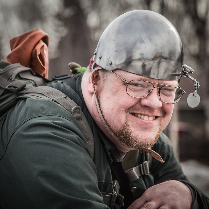 """Insurance defence attorney Greg Henrikson with his unique bicycle helmet on Delaney Park Strip, Anchorage.    """"I ride my bicyle as my main means of transportation...I found this helmet online…it's based on a medieval design and it fits my giant head perfectly.""""  greg@walkereakers.com"""