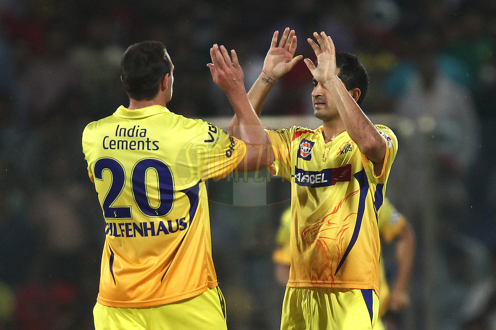 Ben Hilfenhaus of The Chennai Super Kings and Mohit Sharma of The Chennai Super Kings celebrate Dinesh Karthik of the Delhi Daredevils wicket during match 26 of the Pepsi Indian Premier League Season 2014 between the Delhi Daredevils and the Chennai Super Kings held at the Feroze Shah Kotla cricket stadium, Delhi, India on the 5th May  2014<br /> <br /> Photo by Shaun Roy / IPL / SPORTZPICS<br /> <br /> <br /> <br /> Image use subject to terms and conditions which can be found here:  http://sportzpics.photoshelter.com/gallery/Pepsi-IPL-Image-terms-and-conditions/G00004VW1IVJ.gB0/C0000TScjhBM6ikg
