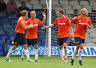 Picture by David Horn/Focus Images Ltd +44 7545 970036<br /> 03/08/2013<br /> Jake Howells (2nd Left) of Luton Town celebrates scoring his side's fourth goal during the Friendly match at Kenilworth Road, Luton.