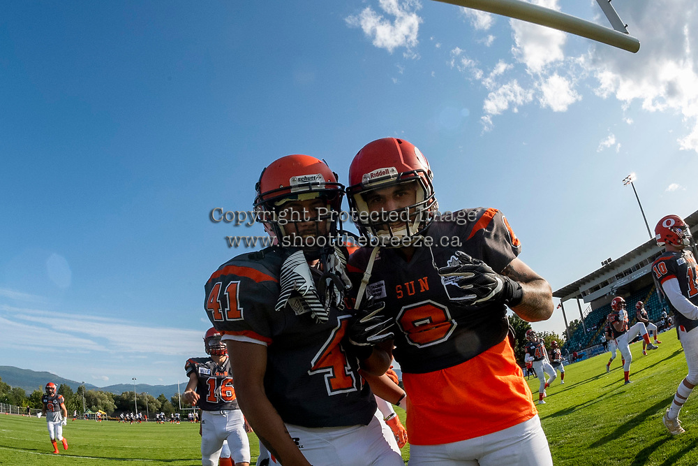 KELOWNA, BC - AUGUST 3: Nate Adams #41 and Kian Ishani #8 of the Okanagan Sun ham it up on the field against the Kamloops Broncos at the Apple Bowl on August 3, 2019 in Kelowna, Canada. (Photo by Marissa Baecker/Shoot the Breeze)