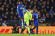 Leicester City midfielder Wilfred Ndidi (25) jumps for the ball with Chelsea goalkeeper Thibaut Courtois (13) punching the ball during the Premier League match between Leicester City and Chelsea at the King Power Stadium, Leicester, England on 14 January 2017. Photo by Jon Hobley.