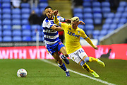 Lewis Baker (16) of Reading battles for possession with Ezgjan Alioski (10) of Leeds United during the EFL Sky Bet Championship match between Reading and Leeds United at the Madejski Stadium, Reading, England on 12 March 2019.