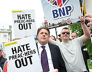 """1st June 2013 <br /> <br /> Protest around Westminster <br /> <br /> Nick Griffin, leader of the British National Party (BNP) speaking on College Green outside the Palace of Westminster in an area cordoned off by Police keeping supporters of United Against Fascism (UAF) and the BNP group apart. The BNP had been banned from marching in Woolwich and moved their rally to Westminster hoping to lay flowers at the Cenotaph in Whitehall but were prevented from doing so. <br /> <br /> A spokesman said: """"Due to police concerns about serious disruption to the life of the community, and the potential for serious disorder should this counter protest confront the BNP organised protest, police have imposed conditions under Section 14 of the Public Order Act.<br /> <br /> Photograph by Elliott Franks"""