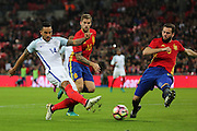 England attacker Theo Walcott (14) shot on goal during the Friendly match between England and Spain at Wembley Stadium, London, England on 15 November 2016. Photo by Matthew Redman.