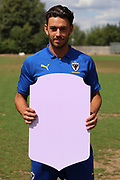 AFC Wimbledon defender Will Nightingale (5) holding Fifa sign during the AFC Wimbledon 2018/19 official photocall at the Kings Sports Ground, New Malden, United Kingdom on 31 July 2018. Picture by Matthew Redman.