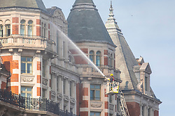 © Licensed to London News Pictures. 06/06/2018. London, UK. A fireman hoses water into the Mandarin Oriental Hotel in Knightsbridge where a fire has broken out. Photo credit: Rob Pinney/LNP