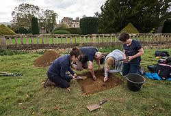 © Licensed to London News Pictures. 13/10/2018. Winchcombe, Gloucestershire, UK. Sudeley Castle. Archaeologists from DigVentures working on site, hoping to unearth a long-lost Tudor garden at Sudeley Castle this weekend. Best-selling historical novelist Dr Philippa Gregory will also be joining the team. Philippa, who's well-known works include The Other Boleyn Girl and The White Queen, started her research into Sudeley Castle whilst working on a novel about Katherine Parr. For nearly 1,000 years, Sudeley Castle has hosted some of England's most famous monarchs including Henry VIII. It is also where Katherine Parr, Henry's last wife, later lived and was finally laid to rest. A recent geophysical survey at Sudeley revealed the ghostly outline of a long-lost Tudor garden, with traces of what could have been a banqueting house in the same area where pieces of Tudor masonry were found in the 19th century. Now experts say it is time to investigate further. The dig will take place at this Saturday and Sunday, October 13 and 14, and is thought to be the most significant archaeological investigation since the discovery of Roman villas on the estate in Victorian times. A specialist team from social archaeology company, DigVentures, will begin an investigation of the site, which aims to 'ground-truth' the geophysics results. They hope to reveal some of the Tudor secrets that remain hidden underground at the castle. Following the popular landscaping movement inspired by Capability Brown, many Tudor gardens were lost, and this is perhaps just one of only two in England where the original paths remain visible. Photo credit: Simon Chapman/LNP