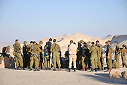 Israel, Negev, Kibbutz Sde Boker Israeli soldiers on a field day, looking out towards Ein Ovdat and the Wadi Zin valley