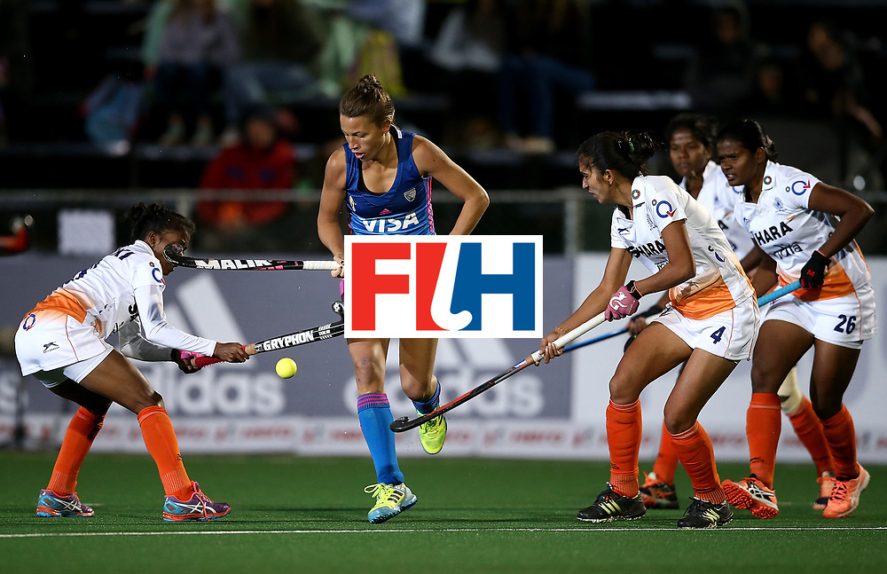 JOHANNESBURG, SOUTH AFRICA - JULY 16:  Delfina Merino of Argentina controls the ball from Nikki Pradhan and Monika of India during day 5 of the FIH Hockey World League Women's Semi Finals Pool B match between Argentina and India at Wits University on July 16, 2017 in Johannesburg, South Africa.  (Photo by Jan Kruger/Getty Images for FIH)