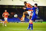 Uche Ikpeazu of Blackpool FC (On loan from Watford FC) holds off Anthony Gerrard of Oldham Athletic during the Sky Bet League 1 match between Oldham Athletic and Blackpool at SportsDirect.Com Park, Oldham, England on 15 March 2016. Photo by Mike Sheridan.