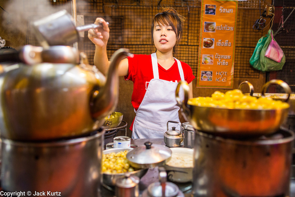 18 SEPTEMBER 2013 - BANGKOK, THAILAND:  A dessert vendor at her cart in the Chinatown section of Bangkok. Thailand in general, and Bangkok in particular, has a vibrant tradition of street food and eating on the run. In recent years, Bangkok's street food has become something of an international landmark and is being written about in glossy travel magazines and in the pages of the New York Times.     PHOTO BY JACK KURTZ