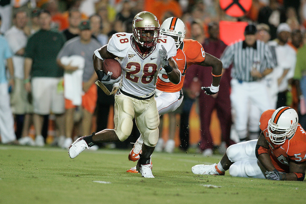 Florida State Seminoles running back Lorenzo Booker eludes Miami Hurricanes defensive back Randy Phillips (6) and defensive lineman Teraz McCray (54) during FSU's 13-10 victory over the Hurricanes on September 4, 2006 at the Orange Bowl Stadium in Miami, Florida.