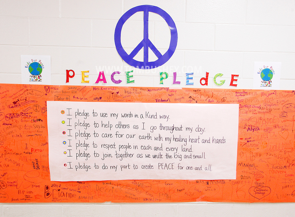Students from Hamilton Bicentennial Elementary School in Cuddebackville signed a peace pleade as part of the Pinwheels for Peace Project on Friday, Sept. 21, 2012.