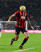 The face of Philip Billing (29) of AFC Bournemouth is hidden by the ball during the Premier League match between Bournemouth and Brighton and Hove Albion at the Vitality Stadium, Bournemouth, England on 21 January 2020.