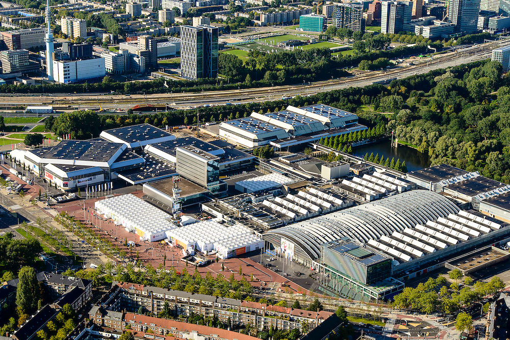 Nederland, Noord-Holland, Amsterdam, 27-09-2015; Europaplein met Rai Congrescentrum. In de achtergrond de Zuid-as.<br /> Congress and conference centre Rai, with in the background the Zuid-as, 'South axis', financial center in the South of Amsterdam.<br /> luchtfoto (toeslag op standard tarieven);<br /> aerial photo (additional fee required);<br /> copyright foto/photo Siebe Swart