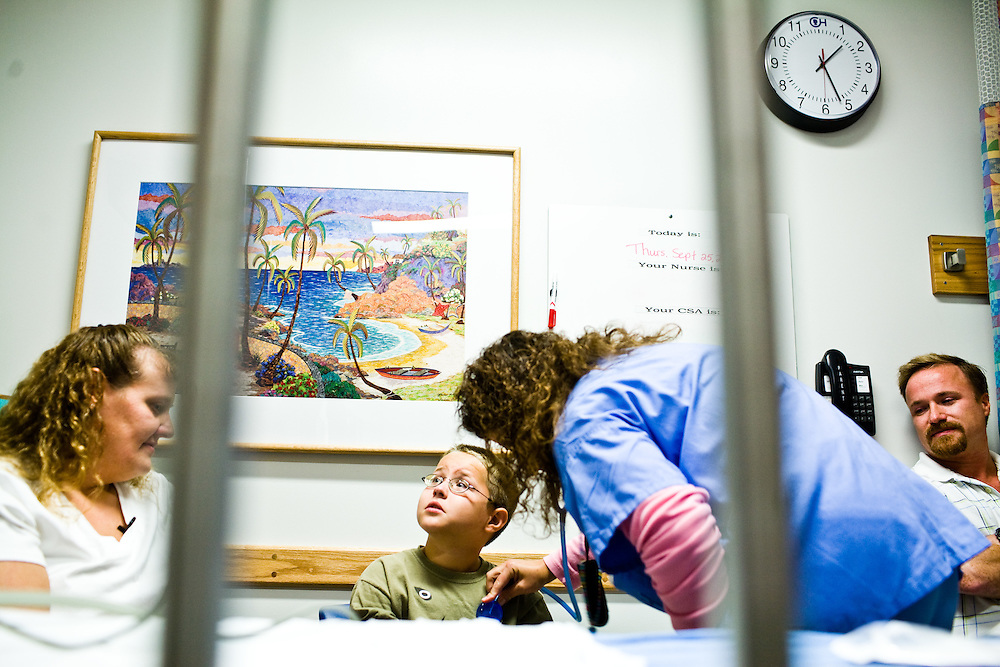Corey Haas, 8, looks up at the monitor as his pulse is checked, before he enters surgery at the UPenn Medical Center in Philadelphia, PA on Thursday, September 25, 2008. Corey is sight-impaired and will undergo surgery injecting genetic material into his left eye in hopes of improving his vision.