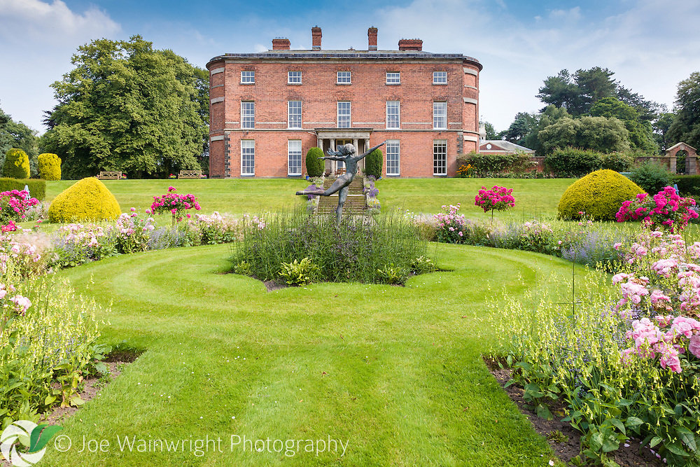 This section of Rode Hall, Cheshire, was built in 1752.  It overlooks this beautiful rose garden, complete with wood nymph bronze by David Williams Ellis.