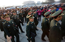 Members of the People's Liberation Army (PLA) arrive for the opening session of the National Peoples Congress (NPC) in the Great Hall of the People in Beijing, China, on 05 March 2011. The NPC has over 3,000 delegates and is the world's largest parliament or legislative assembly though its function is largely as a formal seal of approval for the policies fixed by the leaders of the Chinese Communist Party.
