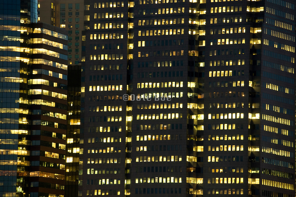 close up of office high rise with the office lights on