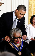 President Barack Obama awards the Medal of Freedom to  Maya Angelou during a ceremony in the East Room of the White House in Washington DC on February 15, 2011. Photo by Kris Connor