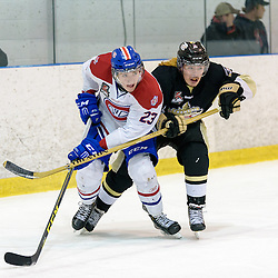 KINGSTON, - Apr 6, 2016 -  Ontario Junior Hockey League game action between Trenton Golden Hawks and Kingston Voyageurs. Game 4 of the North East Championship series.  at the Invista Centre, ON. Jakob Brahaney #23 of the Kingston Voyageurs and Liam Morgan #8 of the Trenton Golden Hawks battle for position during the first period. (Photo by Ian Dixon / OJHL Images)