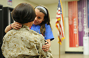 Veronica Davadi, 7, looks tearfully at her mom Deborah Davadi, a hospital corpsman in the United States Navy, as she surprise her daughter after returning from serving in Afghanistan, at her daughter's school Campus Park Elementary in Livingston Thursday. (2-6-14).