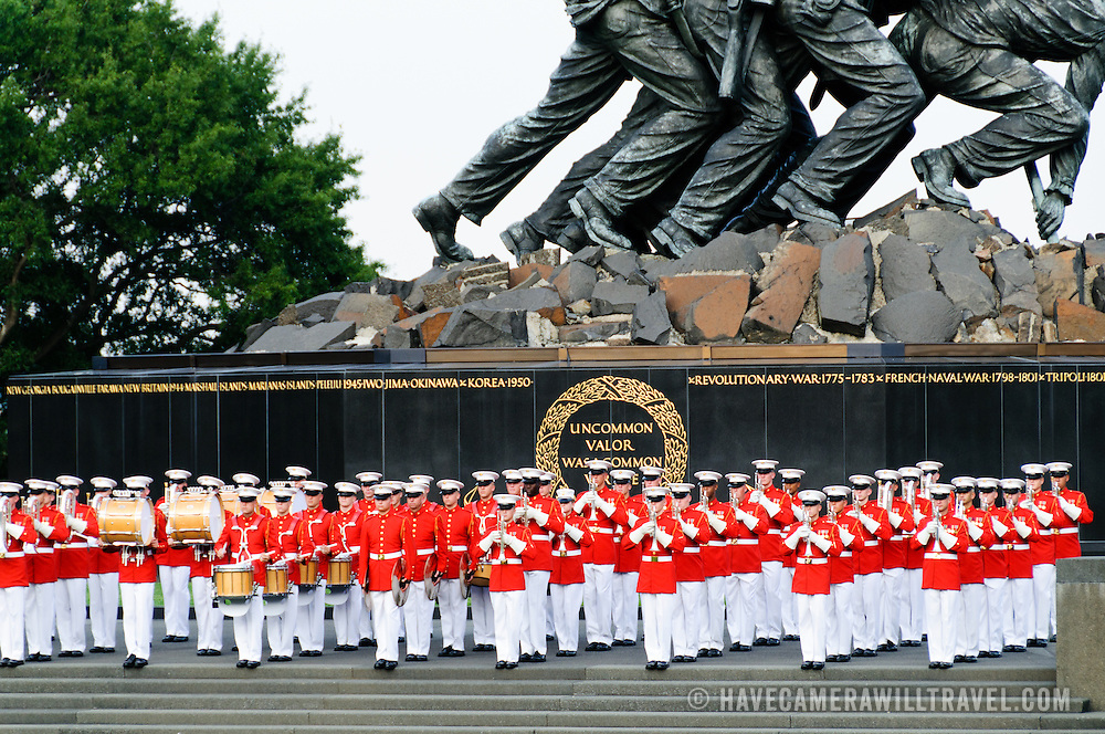 """United States Marine Drum and Bugle Corps, known as """"The Commandant's Own,"""" performing at the Marine Corps Sunset Parade at the Marine Corps Memorial (Iwo Jima Memorial) next to Arlington National Cemetery. Editorial use only."""
