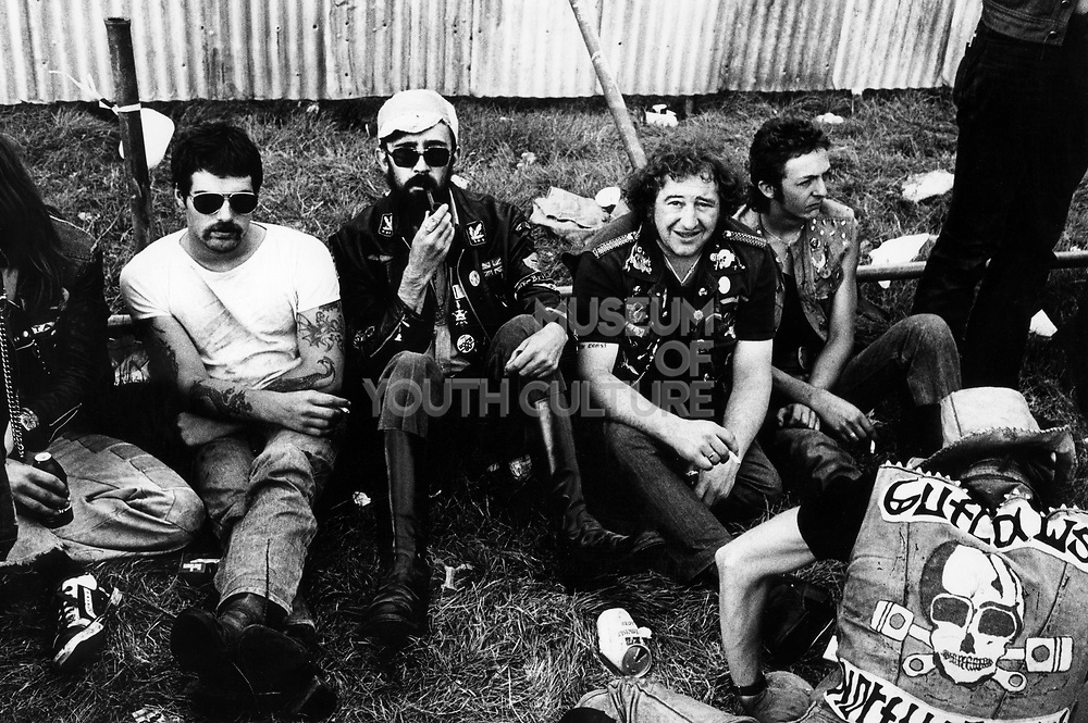 Bikers, Hell's Angels sat down at a rock concert, UK, 1980's