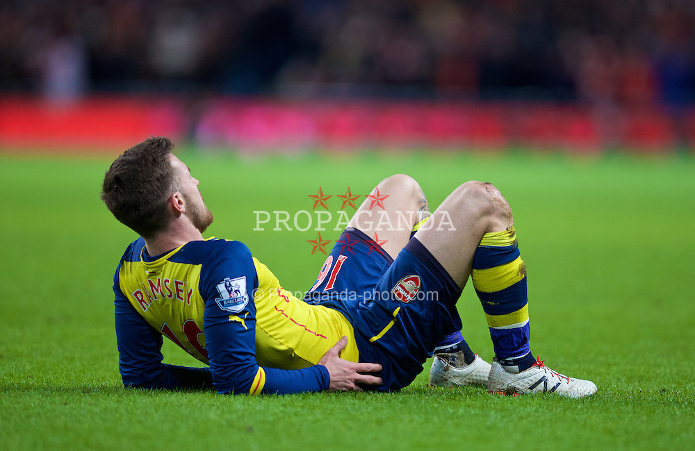 MANCHESTER, ENGLAND - Sunday, January 18, 2015: Arsenal's Aaron Ramsey lies injured during the Premier League match against Manchester City at the City of Manchester Stadium. (Pic by David Rawcliffe/Propaganda)