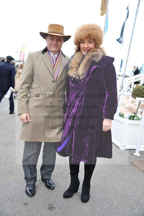 EARL & COUNTESS OF CARNARVON at the Hennessy Gold Cup at Newbury Racecourse, Berkshire on 26th November 2011.